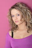 Beautiful blonde girl (woman) in a violet dress Royalty Free Stock Photo