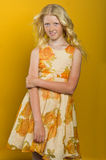 Beautiful blonde girl on a yellow background Royalty Free Stock Images