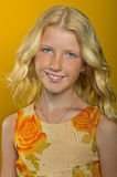 Beautiful blonde girl on a yellow background Royalty Free Stock Photo