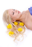 Beautiful blonde girl with yellow flowers in hair Stock Images