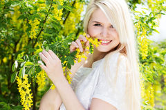 Beautiful blonde girl with yellow flowers Royalty Free Stock Photos