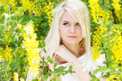Beautiful blonde girl with yellow flowers Royalty Free Stock Photography