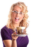 The beautiful blonde gives coffee Stock Images