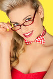 Beautiful blonde in a glasses and a bowtie Royalty Free Stock Photos