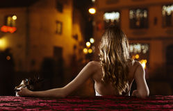 Beautiful blonde with gold Venetian mask Royalty Free Stock Image