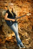 The beautiful blonde with a guitar Stock Image