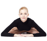 Beautiful blonde gymnast. Portrait of beautiful young blonde woman gymnast working out on white Stock Photo