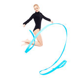 Beautiful blonde gymnast. Portrait of beautiful young blonde woman gymnast jumping with blue ribbon on white stock photo