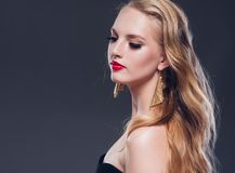 Beautiful blonde hair woman classic style with red lips and eyar royalty free stock image