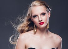 Beautiful blonde hair woman classic style with red lips and eyar stock photo