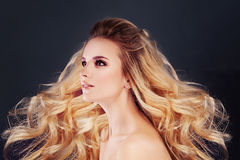 Beautiful Blonde Hair Woman with Permed Curly Hairstyle. Beautiful Blonde Hair Woman Fashion Model with Permed Curly Hairstyle and Makeup Royalty Free Stock Photos