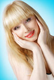 Beautiful blonde with hands on cheek Royalty Free Stock Images