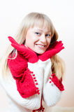 Beautiful blonde happy smiling young woman knitted Royalty Free Stock Photo