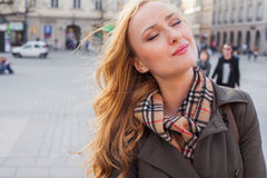 Beautiful blonde happy woman walking on the street in city. Outd Royalty Free Stock Photos