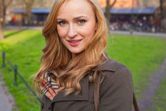 Beautiful blonde happy woman walking on the street in city. Outd Royalty Free Stock Photography