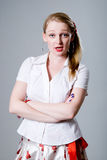 Beautiful blonde has become angry and looks indignantly.  Stock Photo