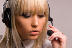 Beautiful blonde in headphones Royalty Free Stock Photography