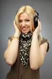Beautiful blonde with headphones Royalty Free Stock Photography
