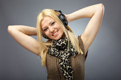 Beautiful blonde with headphones Royalty Free Stock Photos