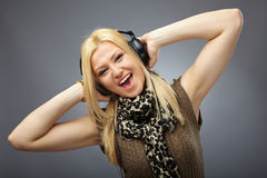 Beautiful blonde with headphones Stock Photography