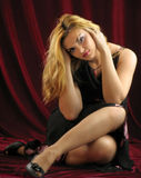 The beautiful blonde with her long hair. Shooting in studio. Royalty Free Stock Image