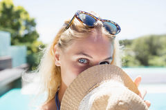 Beautiful blonde hiding face with hat Stock Photography