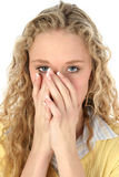 Beautiful Blonde Hiding Mouth stock image