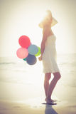 Beautiful blonde holding balloons Royalty Free Stock Photo