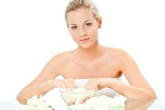 Beautiful blonde  holding hands in boil Stock Photography