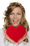 Beautiful blonde holding heart before him Stock Photo
