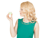 Beautiful blonde holds a cream jar in a hand Stock Photography