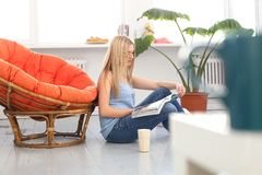 Beautiful blonde at home Royalty Free Stock Photography