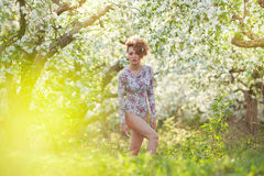Beautiful Blonde In A Spring Garden Stock Photo