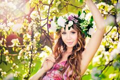 Beautiful Blonde In Wreath With Blossoming Apple Tree Stock Image