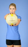 Beautiful blonde indoor volleyball player female Royalty Free Stock Image