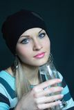 Beautiful blonde keeps glass with water Royalty Free Stock Image