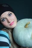 Beautiful blonde keeps pumpkin Royalty Free Stock Photos