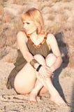 Beautiful blonde in a khaki shirt Stock Image