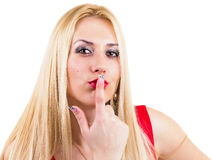 Beautiful blonde kissing her finger. Beautiful blonde her finger kissing looking at camera, isolated on white Stock Photo