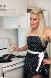 Beautiful Blonde in the Kitchen (4) Royalty Free Stock Images