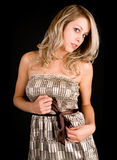Beautiful Blonde Lady in a Beige Dress Royalty Free Stock Photography