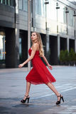 Beautiful blonde lady in red dress on White Square Stock Photos