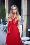 Beautiful blonde lady in red dress on White Square Royalty Free Stock Image
