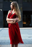 Beautiful blonde lady in red dress on White Square Royalty Free Stock Photo