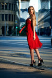 Beautiful blonde lady in red dress on White Square Stock Images