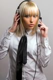 Beautiful blonde listens to music Royalty Free Stock Images