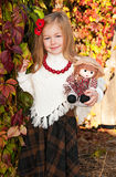 Beautiful blonde little girl with doll Royalty Free Stock Photo