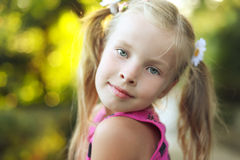 Beautiful blonde little girl on nature Stock Photography