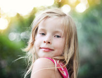 Beautiful blonde little girl on nature Stock Images