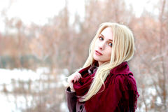 Beautiful blonde with long hair with expectant looks at us, ligh Stock Photo